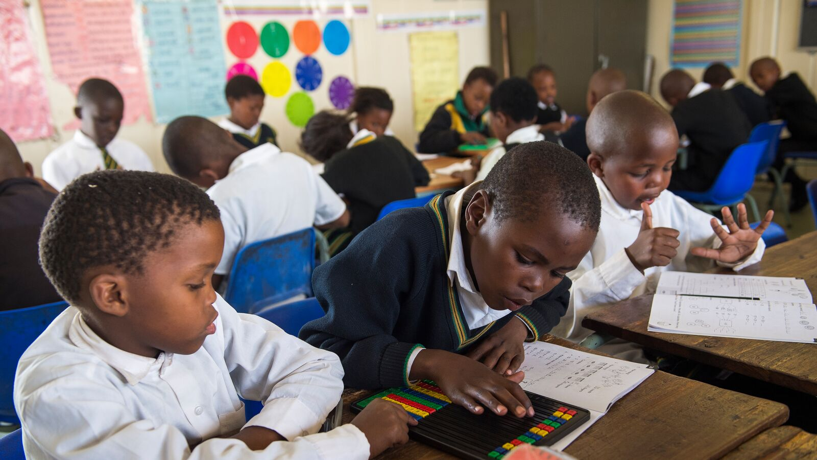 Students using a tablet in South Africa
