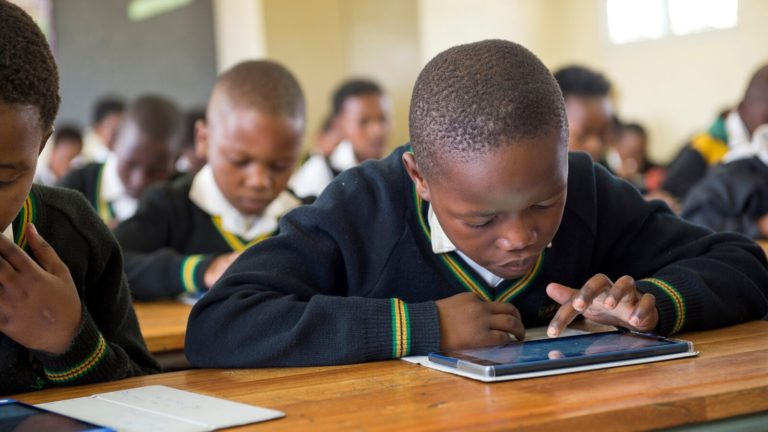 South African student with a tablet benefits from data-driven education