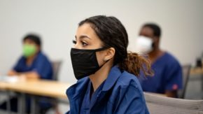 A student at the Central Texas Allied Health Institute attends class in a face mask
