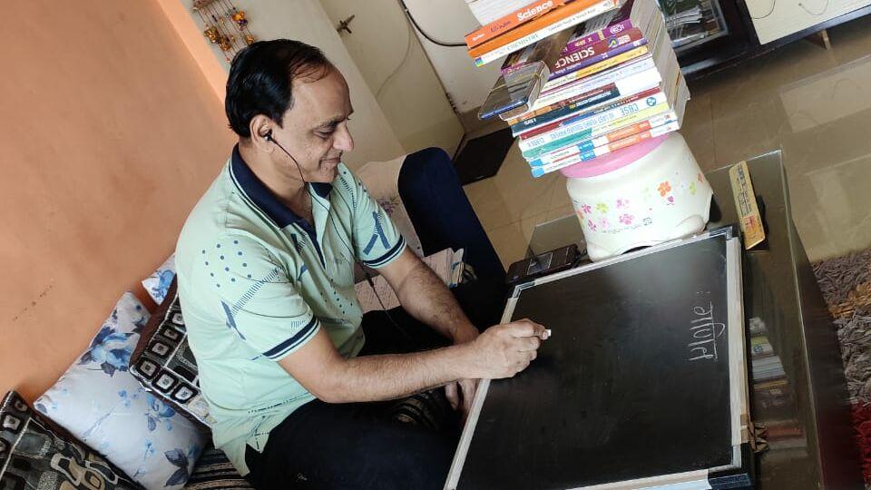 A teacher uses Masoom's virtual classroom technology to teach his students during COVID-19.